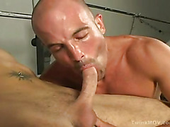 Mature hunk Jack takes off his pants and gets the blowjob of his life from a hot twink.