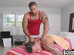 Black muscle stud massages white guy