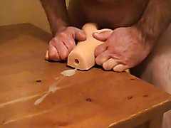 Precum fucking a very tight rubber pussy and a lot of cum