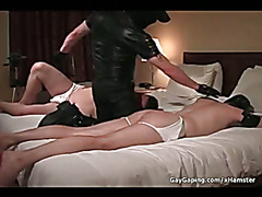 Dirty gay slaves in leather masks gets asses spanked and toy