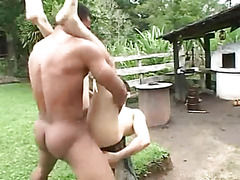This black hunk rams a tight white twinks ass outdoors on a nice hot day.