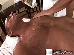 Muscular man gets hot massage