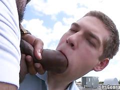 Sucking black cock outdoors