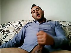 HORNY HANDSOME TURK ON SOFA BUSTING A NUTT