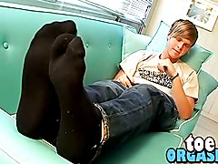 Blond and horny Colby likes to rub toes while jerking off