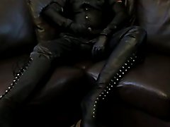 Leather wank in lace up boots.
