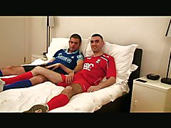 Sexy lads in footie kit fucking on bed