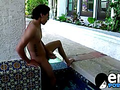 Hot dude Jacob Marteny solo plays with his cock by the pool