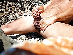 jerking on the beach with cum