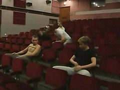 Young gay orgy in auditorium