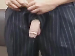 Masturbating in an expensive suit