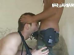 Military guys double team prisoner